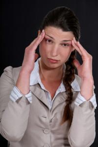 A businesswoman with a headache.